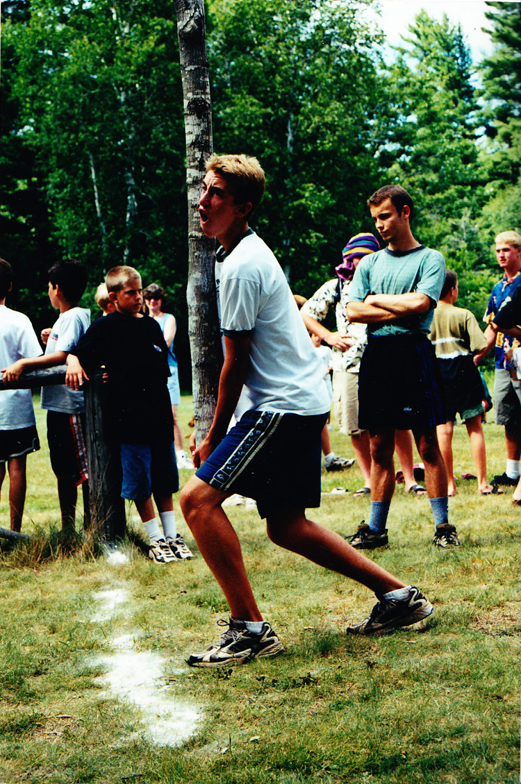Dan, years later (13 or so), doing the caber toss on Paul Bunyan Day—an annual competition of lumberjack-like skills on Parents Visiting Weekend.