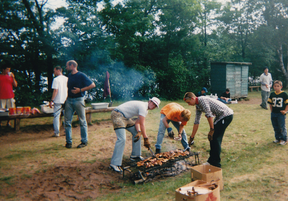 Dan and I (with David Owen) cooking chicken at the all camp BBQ in 2001. Thrift clothes from staff days off in full effect!